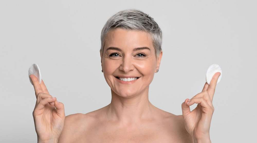 short-haired-middle-aged-woman-smiling-skin-care-concept