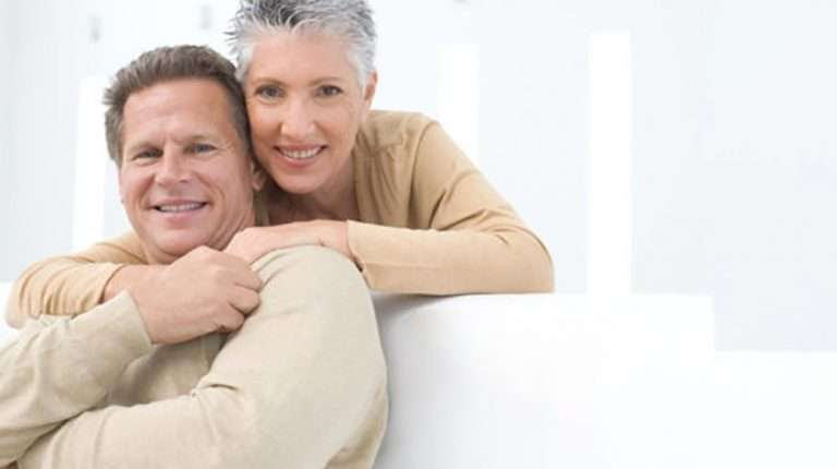 Happy senior couple hugging on the sofa | What is the Fast Start Weight Loss Program?