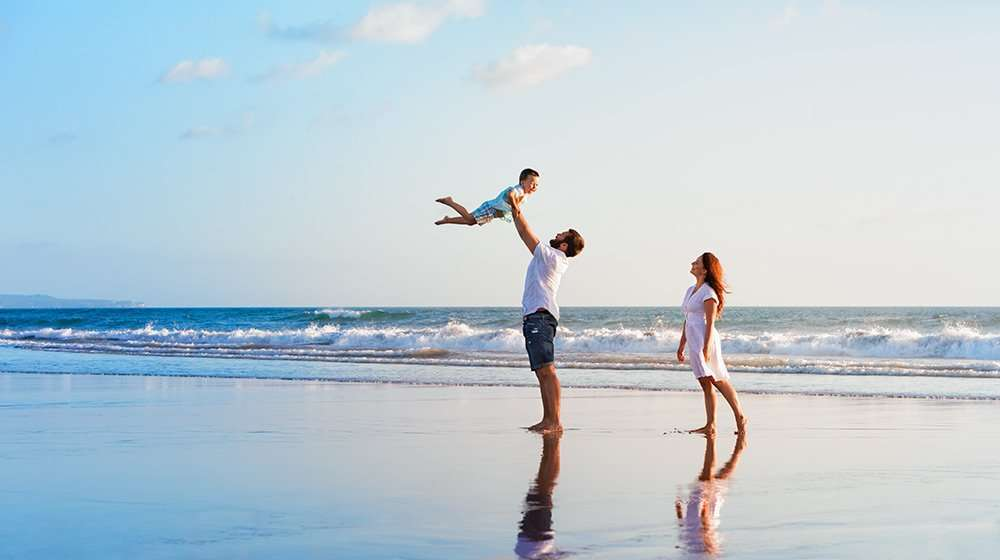 3 happy members of a family having fun at the beach | Feature Image | Immune Boosting Benefits of Thymosin Alpha-1 (TA1) | Peptide and IV Therapy