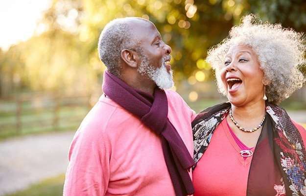 Happy black senior couple smiling with each other | Natural Ways to Slow Down Senescence | The Role Of Senescent Cells And Hormone Therapy
