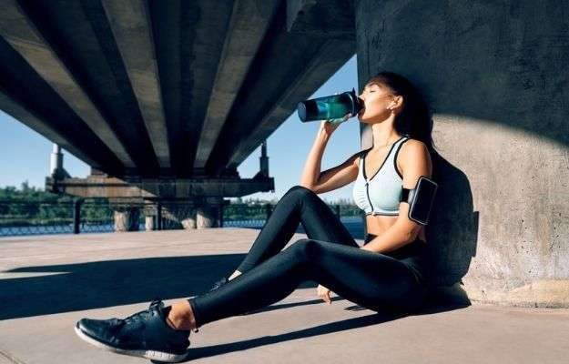 Young fitness woman drinking water from bottle | Benefits of IV Nutrition | IV Nutrition: Why You Should Try It