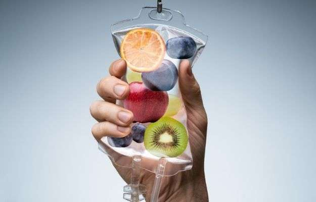 someone is holding a bag having fruit images   What Is IV Nutrition Therapy?   IV Nutrition: Why You Should Try It