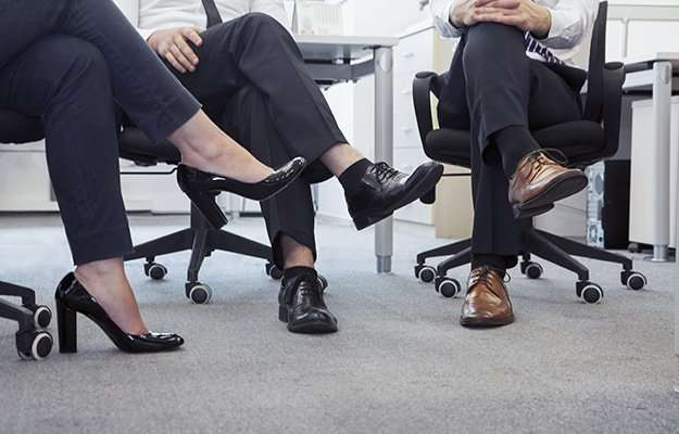a group of people sitting cross-legged in an office | Leg Crossing Causes Varicose Veins | 6 Anti-Aging Myths & Misconceptions