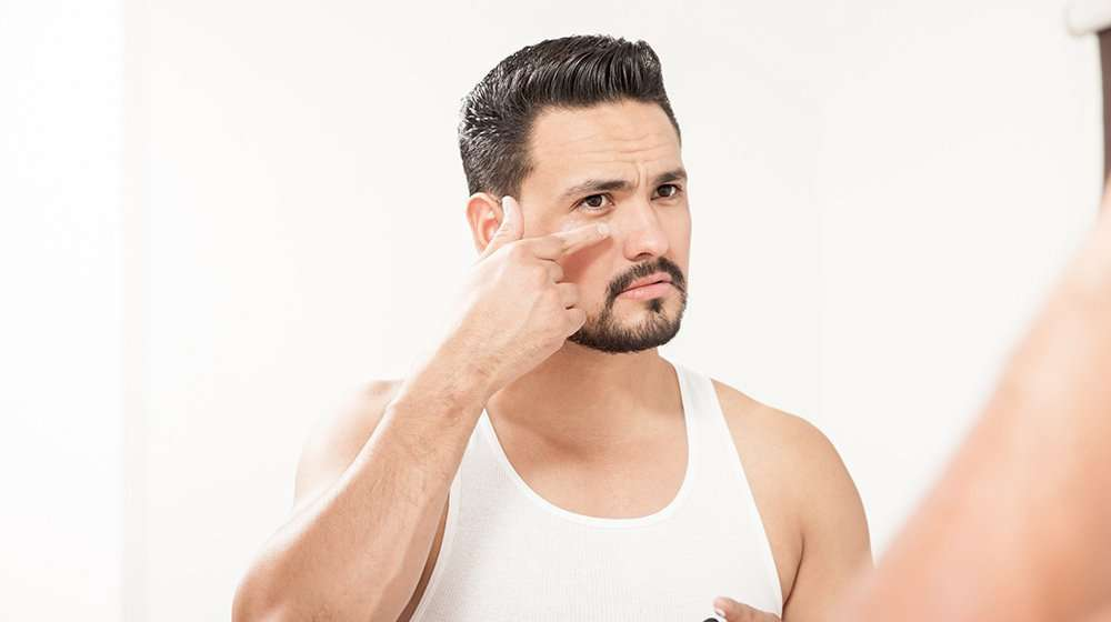 middle age handsome man apply anti aging cream | Feature | 6 Anti-Aging Myths & Misconceptions
