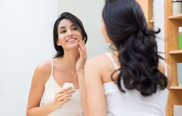 woman is applying cream on her face | Better Skincare | 5 Benefits of Peptide Therapy For Targeted Health Concerns