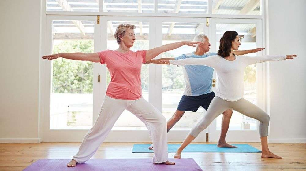 3 people from different age doing yoga in the morning | Feature | YM - Healthy Aging: How to Live A Long And Healthy Life
