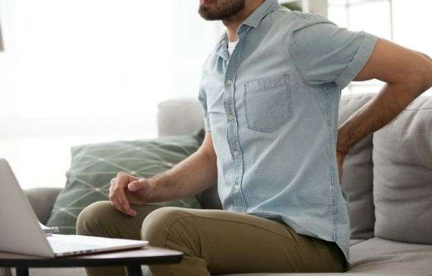 Exhausted tired male suffering from back pain ache   Improves Physical Function   Everything you need to know about MOTS-c Mitochondrial Derived Peptide