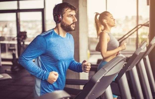 Man and Woman running on treadmill looking tired - Long Life Tips Exercise