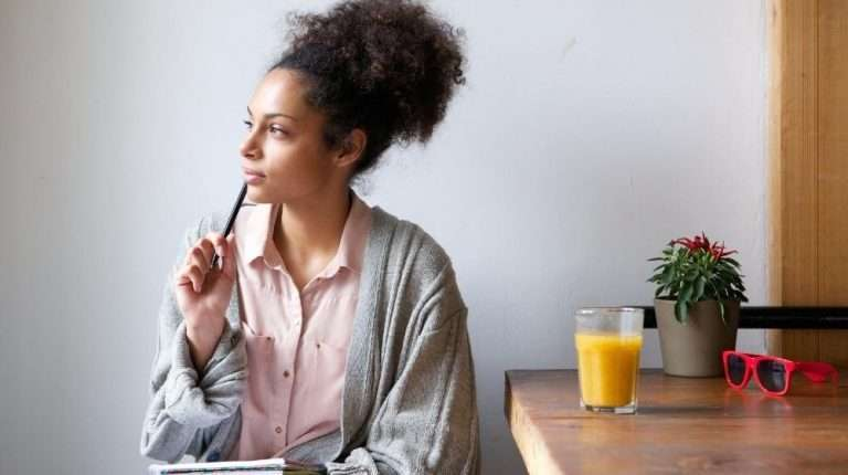 Portrait-of-a-young-woman-sitting-at-home-with-pen-and-paper | Feature | How To Be A Quicker Thinker