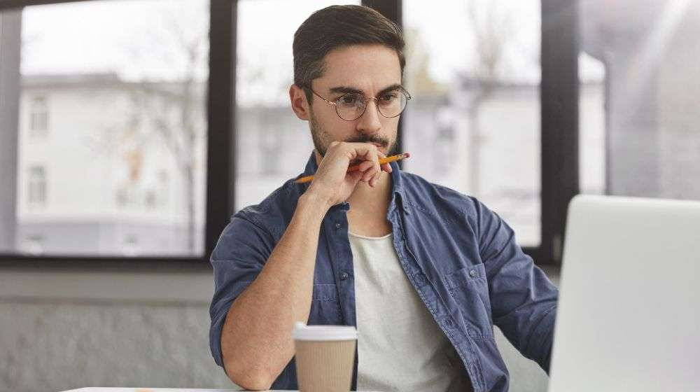 View-of-concentrated-talented-skilled-male-focused-on-screen-of-laptop-computer | Feature | How To Stay Focused Throughout The Busy Day