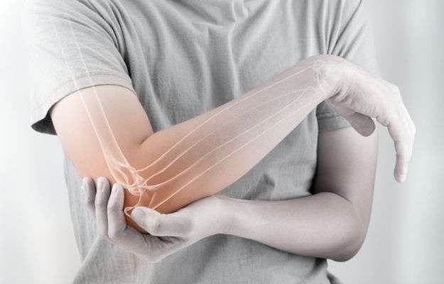a man holding the elbow with the bones image | RA Pain and Inflammatory Markers | Sleep Loss Exacerbates Inflammatory Markers in Rheumatoid Arthritis Patients