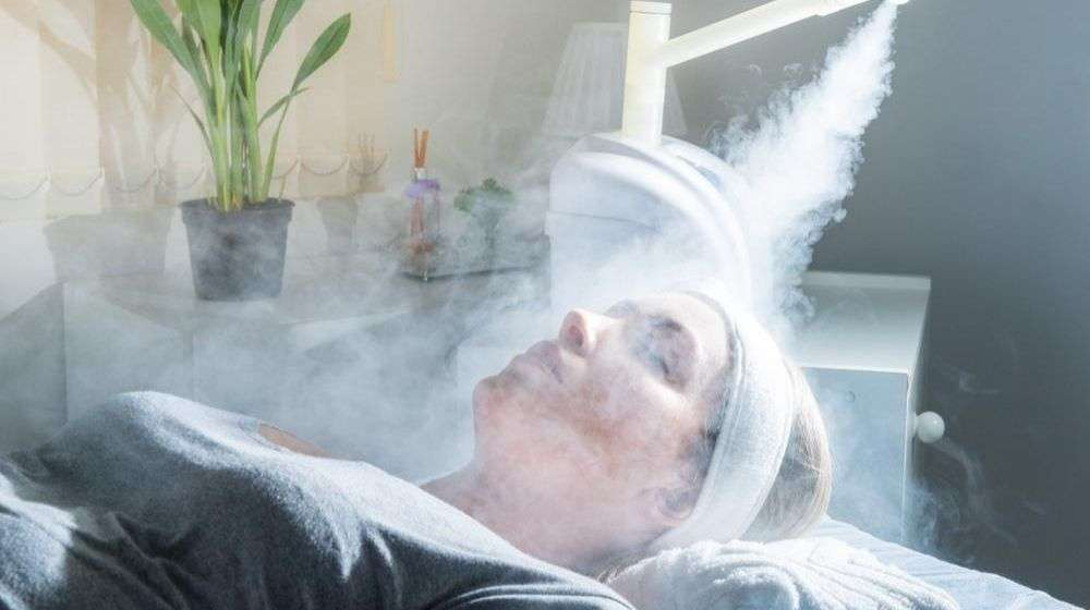 a-women-is-using-ozone-facial-steamer | Feature | 10 Benefits of Ozone Therapy (O3)
