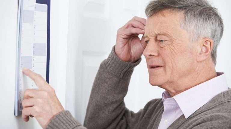 an-old-man-standing-in-front-of-the-calendar | Feature | How To Avoid Alzheimer's and Dementia (6 Ways)
