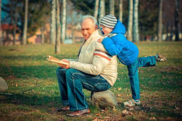 grandpa-read-book-with-grandson-outdoors-during-autumn | Overview | Age-Related Mental Decline Could Be Reversed With New Drug