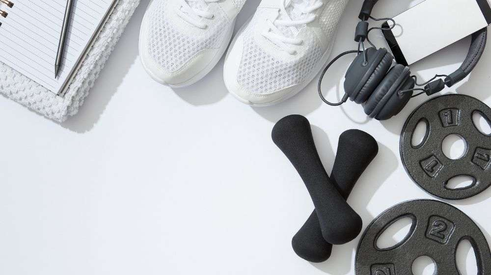 gym gears with headphone, shoe and note | feature | 5 Steps to Increase Stamina and Fight Fatigue