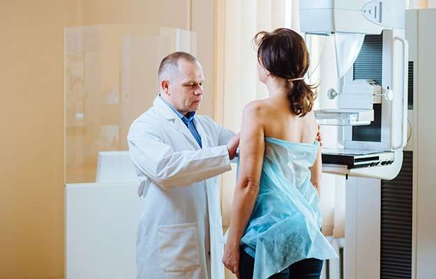 Doctor examining woman in hospital   A Case Study   Treating Invasive Breast Cancer with Testosterone Implants: A Case Study