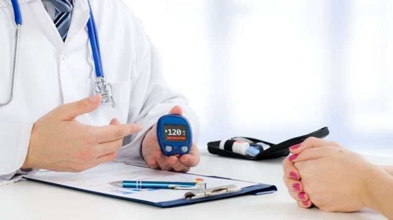Doctor-shows-glucometer-with-glucose-level | feature | Is Diabetes an Autoimmune Disease? And What Are Possible Treatment Options?