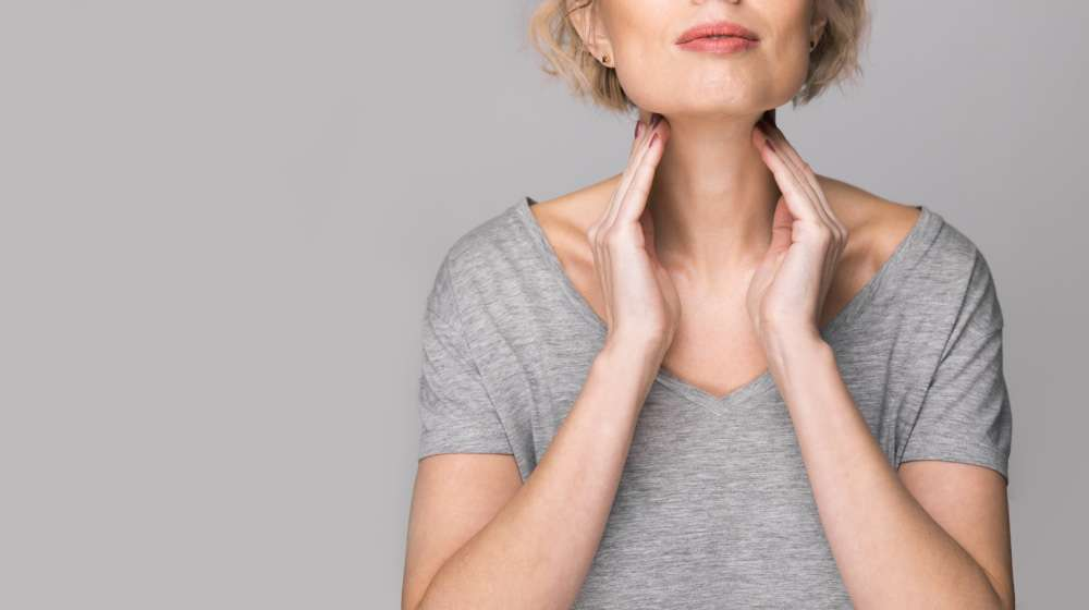 Female-checking-thyroid-gland-by-herself | 4 Special Diets To Help Manage Hypothyroidism | feature