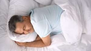 Man-sleeping-on-comfortable-pillow-in-be | feature | 4 Ways To Improve Sleep For Better Health