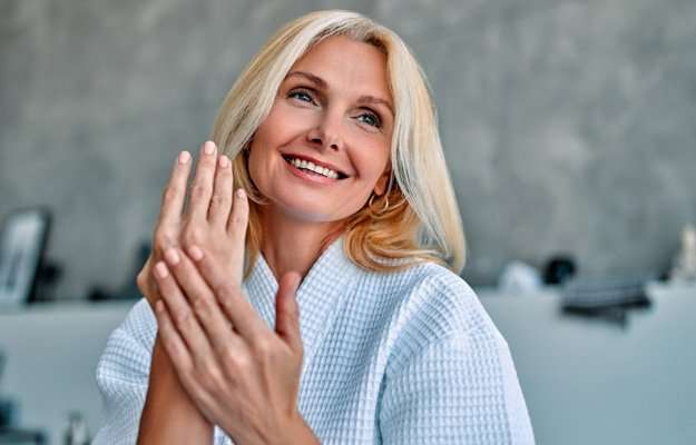 middle age woman with flawless skin - SS   Peptides: Their Benefits On Functional Medicine   Treat Autoimmune Skin Disorders