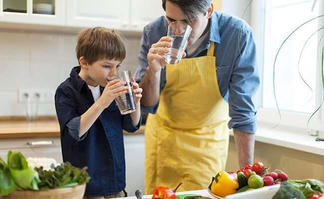 Dad and son drinking water   3 Surprising Ways Epigenetics Can Add Years to Your Life