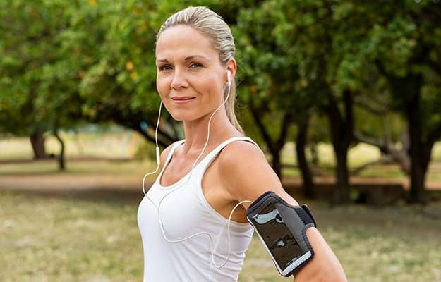 Smiling woman jogging in the morning   Menopause Weight Gain: What It Is and How to Combat It