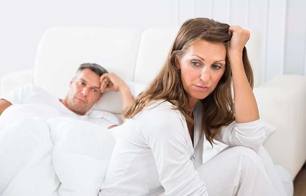 Unhappy woman in bed because of having decrease sexual desire | Signs and Symptoms of Estrogen Dominance