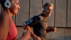 man-in-headphones-running-with-his-wife-through-th…ncrease-Focus,-Energy,-and-Performance   feature   How To Increase Focus, Energy, and Performance