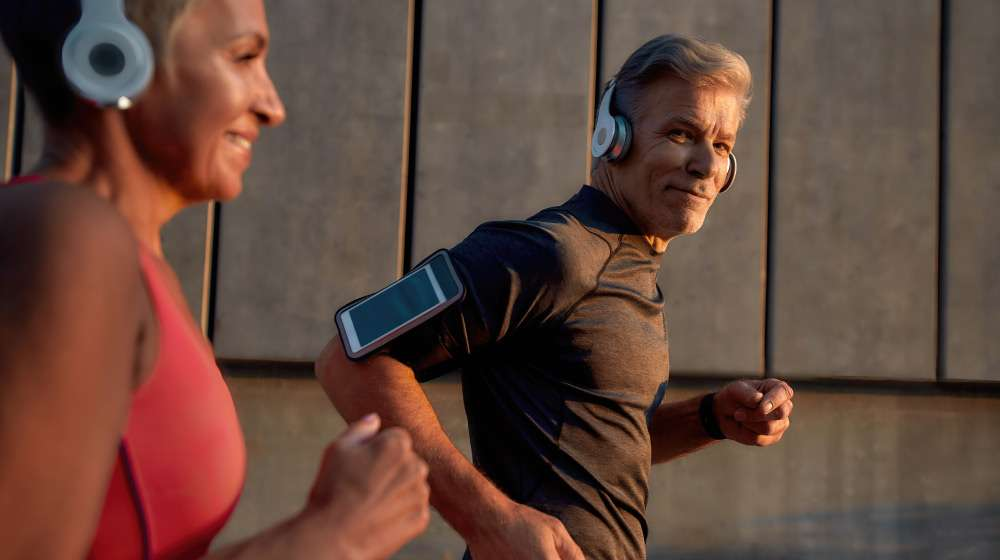 man-in-headphones-running-with-his-wife-through-th…ncrease-Focus,-Energy,-and-Performance | feature | How To Increase Focus, Energy, and Performance