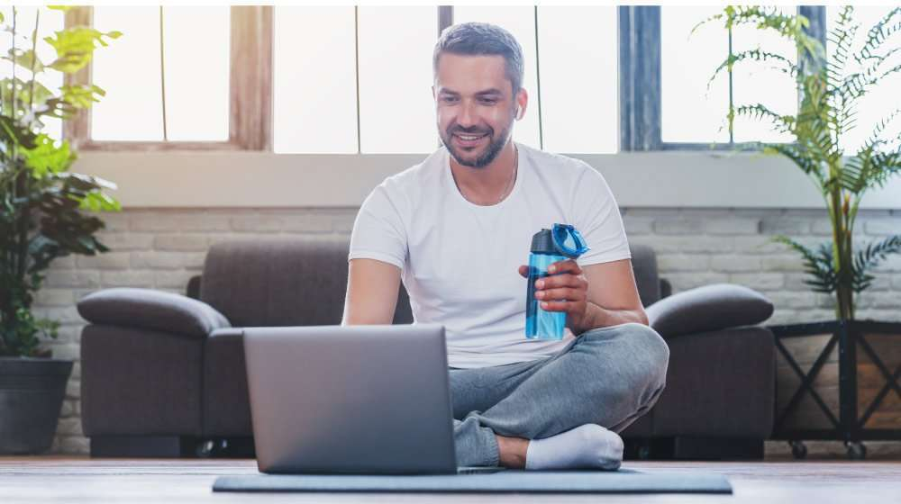 adult-man-using-laptop-and-drinking-water-while-ha…escription-Weight-Loss-Medication-Work | feature | What Is Prescription Weight Loss Medication Work & How Does It Work?