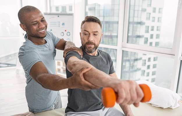 man being guided by expert for a better posture while lifting dumbell   How To Maintain A Healthy Weight?