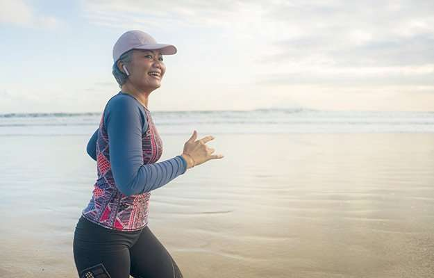 woman running on the beach with her athletic outfit   How To Maintain A Healthy Weight?