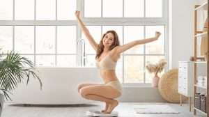 A happy woman on sacle after loss weight sucessful | Feature | Everything You Need To Know FDA Approved New Weight Loss Drug Semaglutide
