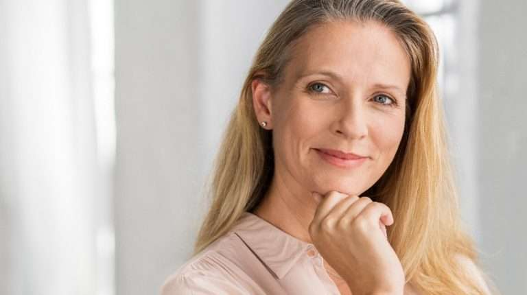 A portrait of a middle age woman | Feature | Everything You Need to Know About NAD+ Therapy