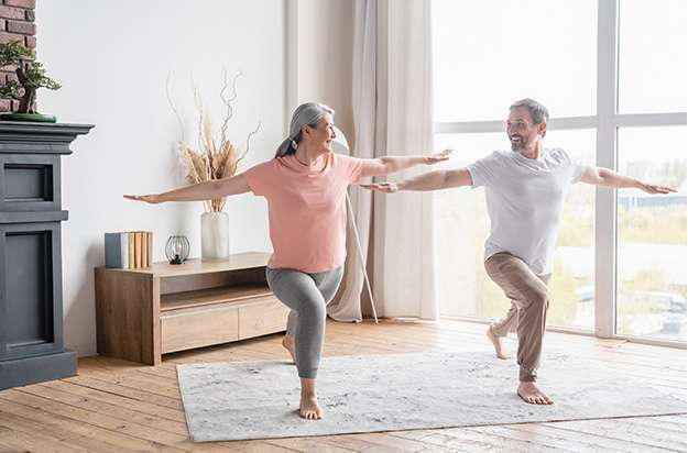Middle-aged couple training stretching doing yoga exercises together   The Important Role of Muscle Mass in Our Health As We Age