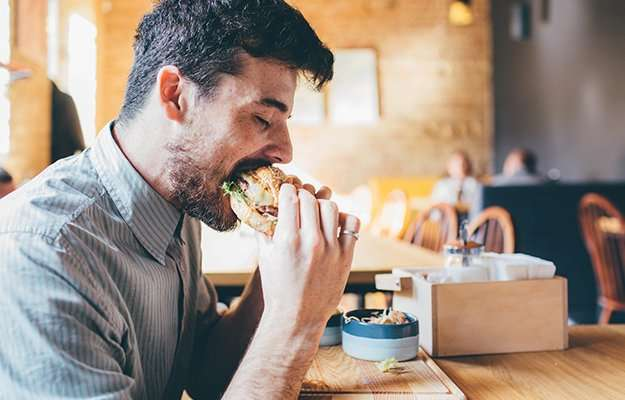 Man-is-eating-in-a-restaurant-and-enjoying-delicious-food-ss-body   How To Deal With Post Covid Fatigue Syndrome